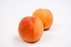 mat isolerade röd white för persika Royaltyfri Bild