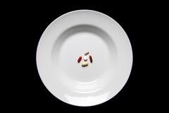 mat isolerade servingsupplements Fotografering för Bildbyråer