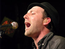 Mat Kearney - Live Performance. This is an image of Mat Kearney performing in concert. Mat Kearney is a popular musician from the United States Stock Photos