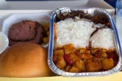 Mat tjänade som i en passagerarflygplan under flyget Mål på t arkivbild