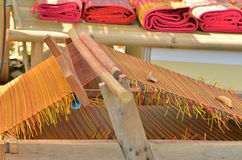 Mat weaving machine. The application of indigenous weaving thread Stock Images
