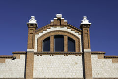 Matadero Madrid. Detail of the front facade of one of the main pavilions in Matadero Madrid, a former slaughterhouse converted to an arts centre Royalty Free Stock Photo
