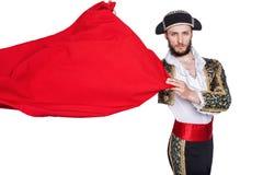 Matador, der ein rotes Kap wirft lizenzfreies stockfoto