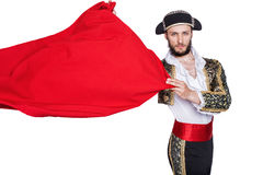 Matador throwing a red cape. Matador throw a red cape. Studio portrait isolated on a white background Royalty Free Stock Photo