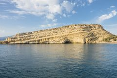Matala Beach. Beach in the village Matala , Crete , Greece , Europe . At eveniing time Royalty Free Stock Photography