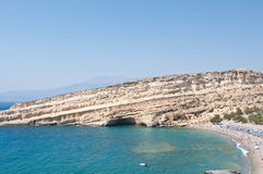 Matala beach on the boundaries of the plain Messara and Asteroussia Mountains on the Crete island, Greece. Royalty Free Stock Photography