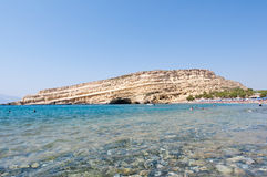 Matala beach with the caves and clean water. Crete, Greece. Royalty Free Stock Photo