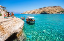 Matala beach with caves on the rocks, Crete, Greece. Matala beach with caves on the rocks that were used as a roman cemetery and at the decade of 70`s were Royalty Free Stock Images