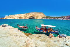 Matala beach with caves on the rocks, Crete, Greece Royalty Free Stock Images