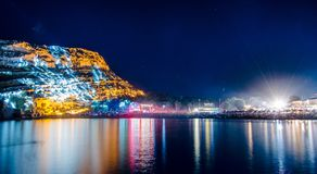 Beautiful Matala beach and cliff at night, Crete Island. Matala beach with caves on the rocks that were used as a roman cemetery and at the decade of 70`s were Stock Photo