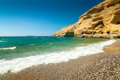 Matala beach and cliff with caves on the island of Crete, Greece royalty free stock photography