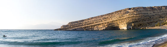 The Matala beach and cliff with caves Royalty Free Stock Photo