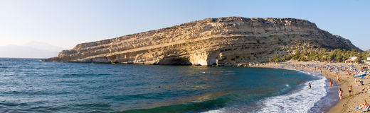 The Matala beach and cliff with caves Stock Photos