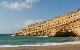 Matala beach cliff Crete Stock Images