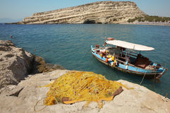 Matala beach with fishing boat in Crete. Greece Royalty Free Stock Photo