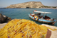 Matala beach with fishing boat in Crete. Greece Royalty Free Stock Images