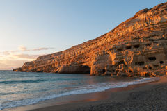 Matala beach. Sunset over Matala beach clif, Crete Royalty Free Stock Photos