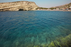 Matala beach with turquoise water in Crete. Greece Royalty Free Stock Photos