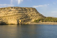 Matala Beach. Beach in the village Matala , Crete , Greece , Europe . At sanset Time Stock Image