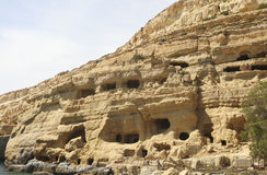 Matala caves in Crete. Ancient caves in  Matala in Crete. Holiday destination in the sixties for many famous popsingers like Bob Dylan and Jodie Mitchell Stock Photo