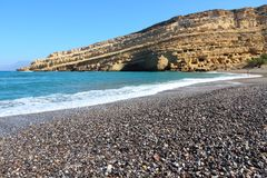 Matala, Crete. Coast of Crete island in Greece. Pebbly beach of famous Matala. There are old Neolithic caves in the limestone rock Royalty Free Stock Images
