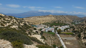 Matala. Overlooking the village of Matala. The mountain and caves are a popular destination for hippies in the 60s - 70s. The Island Of Crete, Greece Royalty Free Stock Photo