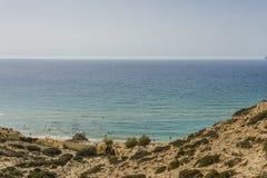 Matala röd strand arkivbild