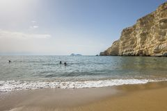 Matala , Red beach. Red Beach,  near Matala, Crete, Greece , Europe . Nudist and hippie beach. People in the sea water Stock Images