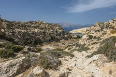 Matala , Red beach. Trail of the mountain on a nudist and hippie beach red beach near Matala, Crete, Greece , Europe Royalty Free Stock Image