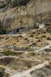 Matala , Red beach. Trail of the mountain on a nudist and hippie beach red beach near Matala, Crete, Greece , Europe .Caves, dwelling hippies Royalty Free Stock Photo