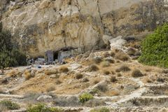 Matala , Red beach. Trail of the mountain on a nudist and hippie beach red beach near Matala, Crete, Greece , Europe .Caves, dwelling hippies Stock Image