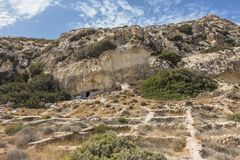 Matala , Red beach. Trail of the mountain on a nudist and hippie beach red beach near Matala, Crete, Greece , Europe .Caves, dwelling hippies Royalty Free Stock Photos