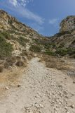 Matala , Red beach. Trail of the mountain on a nudist and hippie beach red beach near Matala, Crete, Greece , Europe Stock Image