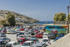 Matala street. Cars on the parking lot in Matala village , Crete , Greece , Europe Royalty Free Stock Images