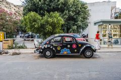 Matala street. Colorful hippie car  in Matala village , Crete , Greece , Europe . At sunset time Royalty Free Stock Images
