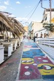Matala street. Colorful street with restaurants and taverns in Matala village , Crete , Greece , Europe royalty free stock photography