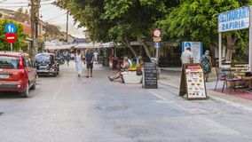 Matala street. Colorful street with  restaurants and taverns in Matala village , Crete , Greece , Europe . At sunset time Stock Images
