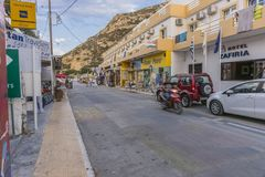 Matala street. Colorful street with  restaurants and taverns in Matala village , Crete , Greece , Europe . At sunset time Stock Image