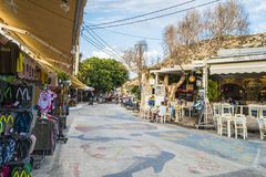 Matala street. Colorful street with  restaurants and taverns in Matala village , Crete , Greece , Europe . At sunset time . Bazaar on the street Stock Photography