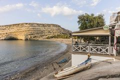 Matala street. Colorful street with  restaurants and taverns in Matala village , Crete , Greece , Europe . At sunset time . View on the tavern and beach Royalty Free Stock Photography