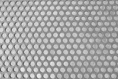 Matalic银色穿孔的栅格纹理背景  库存图片