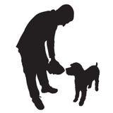 Matande hund för man Arkivfoto