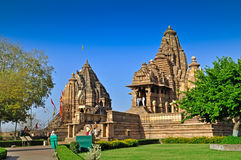 Matangeshvara (left) and Lakshmana Temple -Khajuraho. Khajuraho, Madhya Pradesh , India - March 2011 :  Foreign visitors at Matangeshvara and Lakshmana Temple Royalty Free Stock Photos