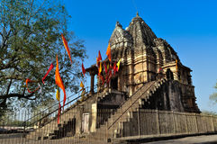 Matangeshvara Temple, Khajuraho, India - UNESCO heritage site,. Devotees at Matangeshvara Temple, dedicated to Lord Shiva, Western Temples of Khajuraho Stock Image