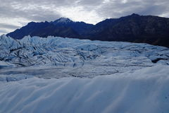 Matanuska Glacier Alaska. Looking across the ice of the Matanuska Glacier in Alaska, near Anchorage. A popular tourism destination. Mountains in background royalty free stock image
