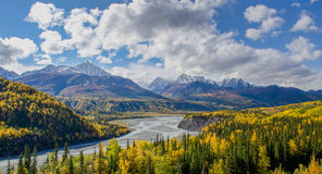The Matanuska River flows below the Chugach Mountains in Alaska Stock Photos