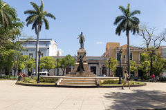 Matanzas. Cuba - main square. Palm trees and statue depicting Jose Marti and Liberty Stock Photos