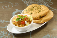 Matar kulcha or Dried yellow peas chaat with pan cooked bread Stock Photography