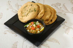 Matar kulcha or Dried yellow peas chaat with pan cooked bread Royalty Free Stock Image