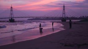 MATARA, SRI LANKA - MARCH 2014: View of people in front of suspension bridge linking pigeon island to Matara. stock video